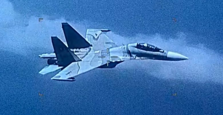 a Venezuelan sU-30 fighter jet intercepts a US Navy EP-3 II surveillance aircraft during a scheduled mission on Friday
