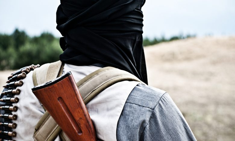 Backshot of a Taliban insurgent.