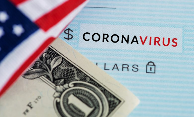 "Concept of coronavirus relief showing an American flag over a dollar and check with the words ""coronavirus"""