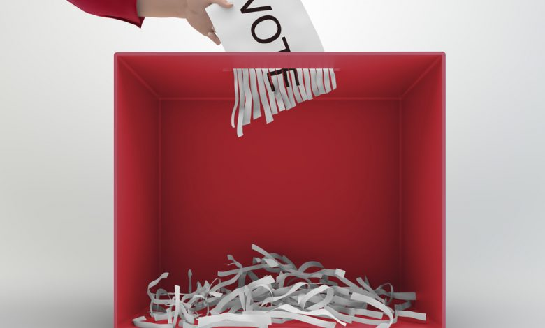 A paper shredder used as a ballot box.