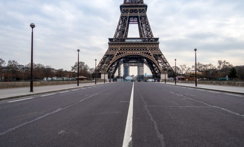 Empty Iena bridge in front of Eiffel Tower during Covid-19 Lockdown in Paris.