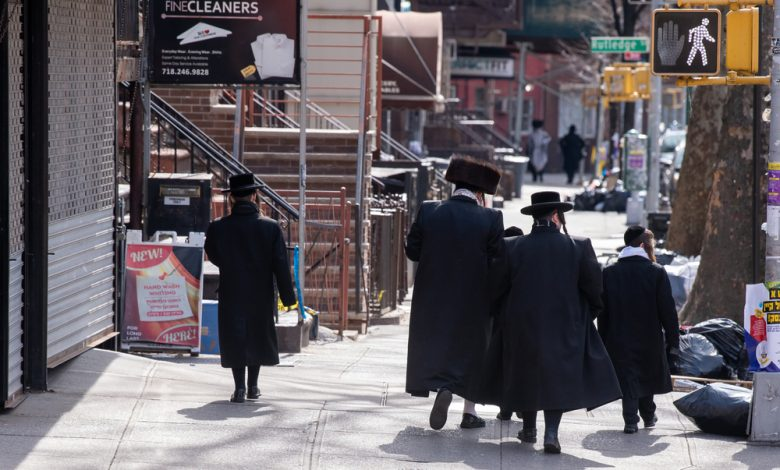 Jewish father and sons are seen walking to Sabbath Prayers as the coronavirus continues to spread across the United States.