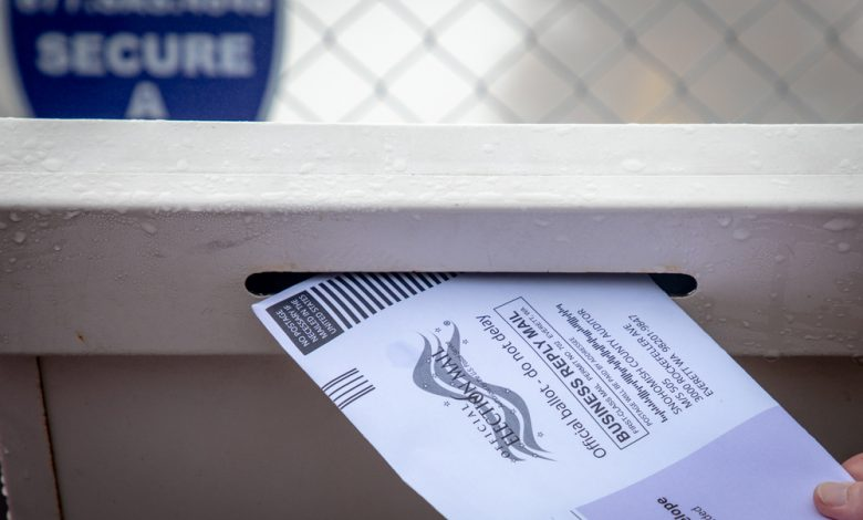 Image of mail in ballot dropped off at ballot box