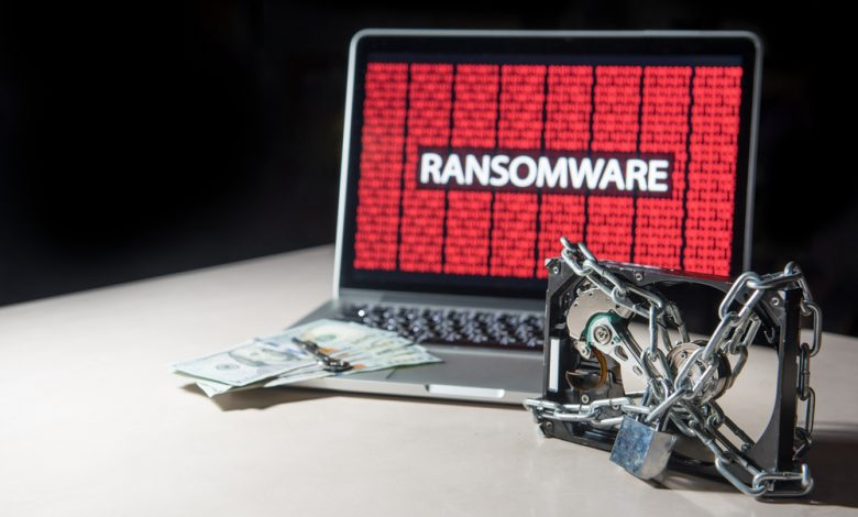 Malware ransomware concept showing an image of an infected computer and a chained hard drive.