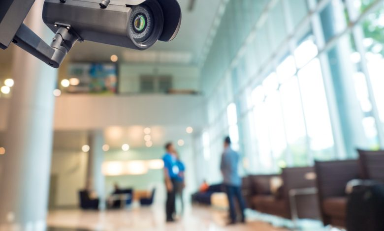 Security CCTV camera surveillance system in an office building.