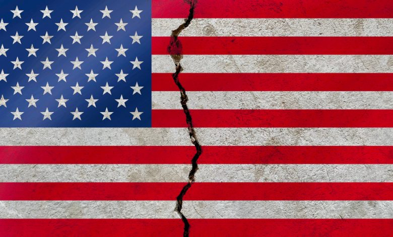 United States national flag pattern isolated on weathered broken cracked wall.